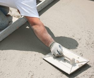 Close up picture of our contractor finishing the concrete for a new driveway in Toledo, OH